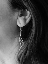 grayscale-photo-of-woman-s-hook-earrings-989967